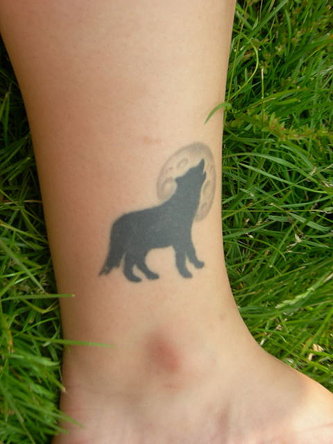 Howling Wolf  At Full Moon Tattoo On The Ankle photo - 3
