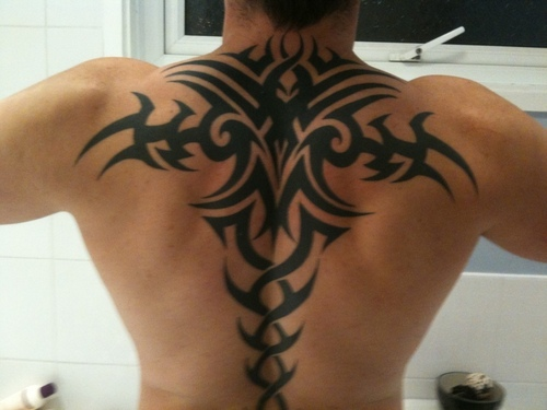 Indian Tribal Tattoo On Upper Back photo - 1