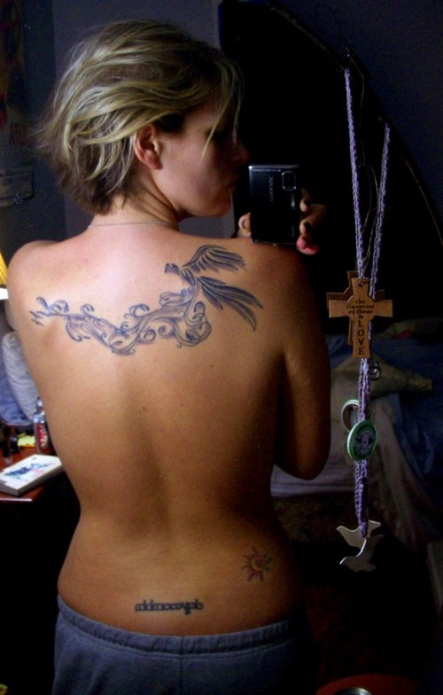 Indian Tribal Tattoo On Upper Back photo - 3