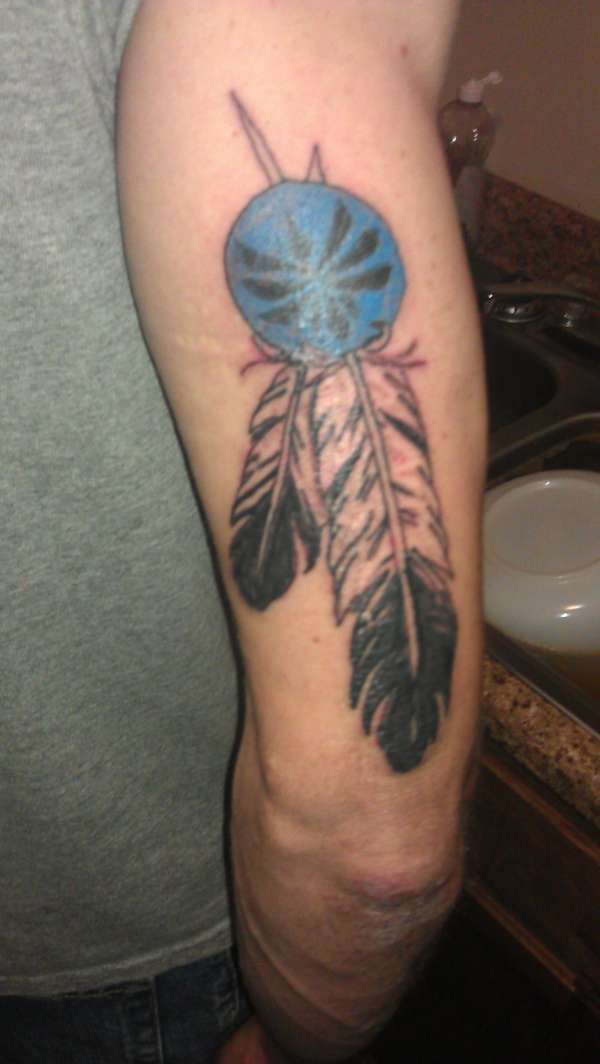 Indian War Feather Tattoo On Back Of Arm photo - 1