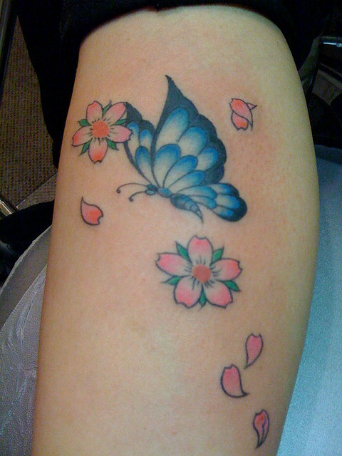 Lady With The 3D Butterfly Tattoo photo - 3