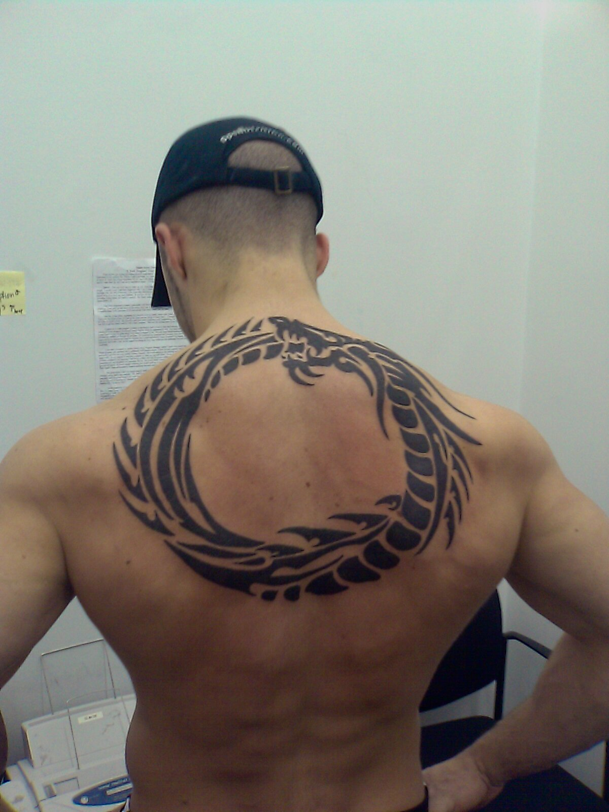 Latest Tribal Tattoo Design For Lower Back photo - 1