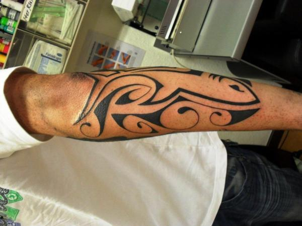 Left Half Sleeve Bold Black Ink Tribal Tattoo photo - 2