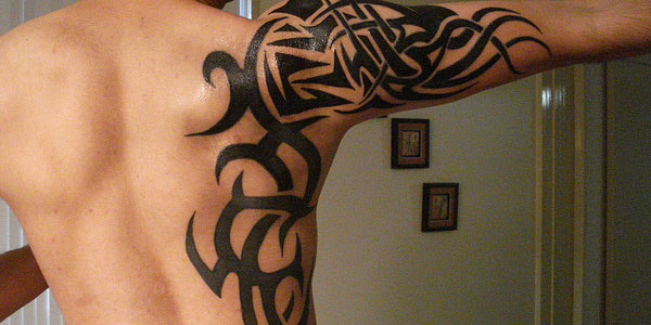 Leo Tribal Tattoo On Back Shoulder For Men photo - 1