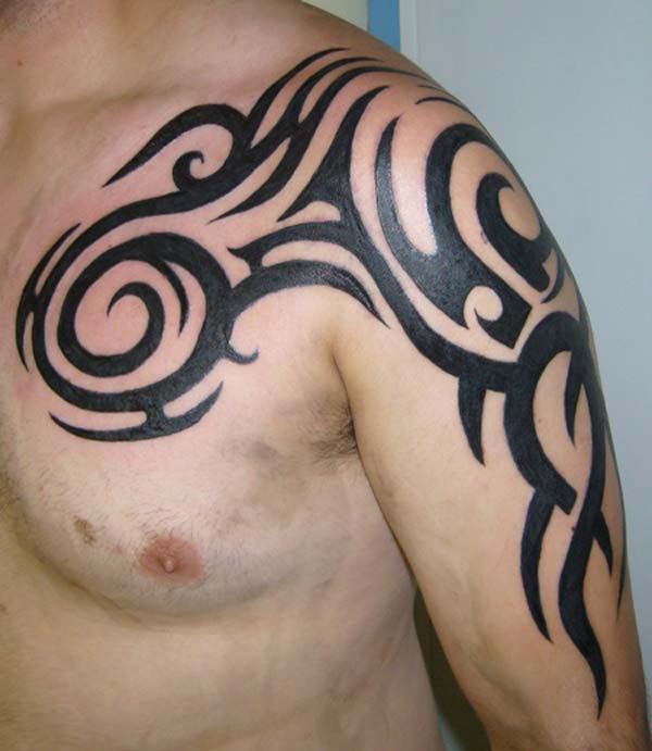 Leo Tribal Tattoo On Back Shoulder For Men photo - 3