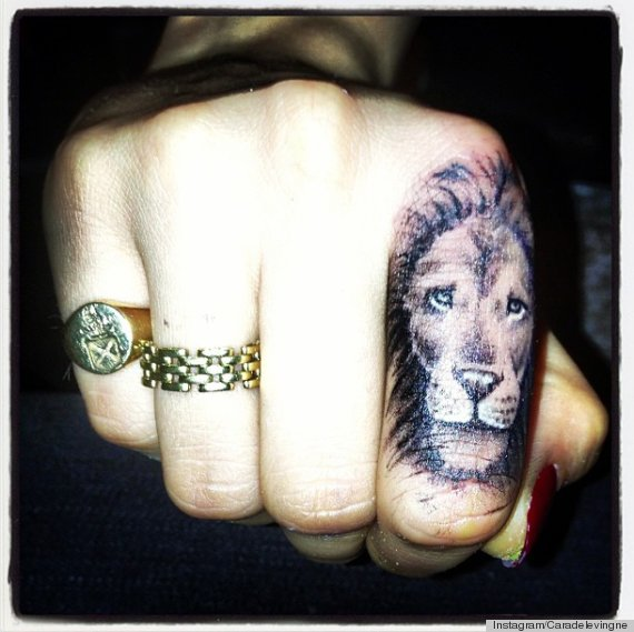 Lion In Jungle Tattoo On Biceps photo - 1