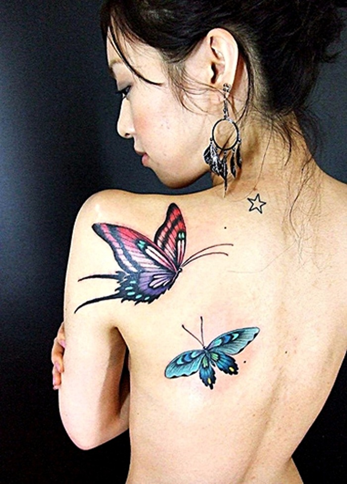 Lovely Tribal Butterflies Tattoos On Back Of Shoulder photo - 1