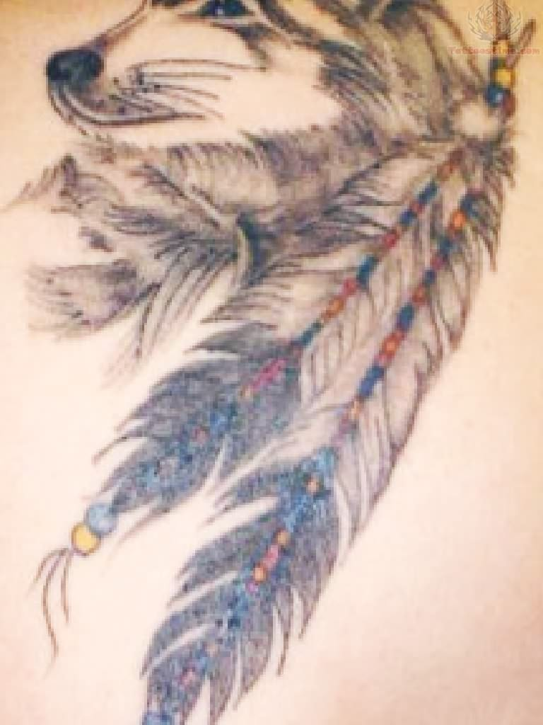 Native American Feather Tattoo On Biceps photo - 1