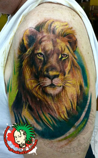 Nice Animal Head Tattoo On Biceps photo - 1