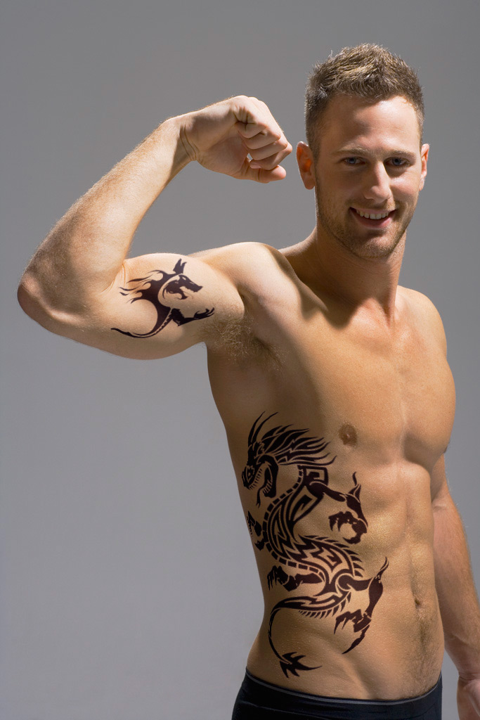 Nice Black Ink Tribal Deer Tattoo On Biceps photo - 2