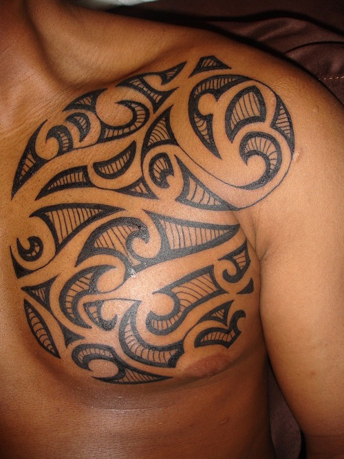 Nice Black Ink Tribal Tattoo On Belly photo - 1