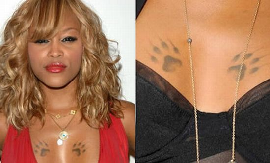 Paws Tattoo On Celebrity Chest photo - 1