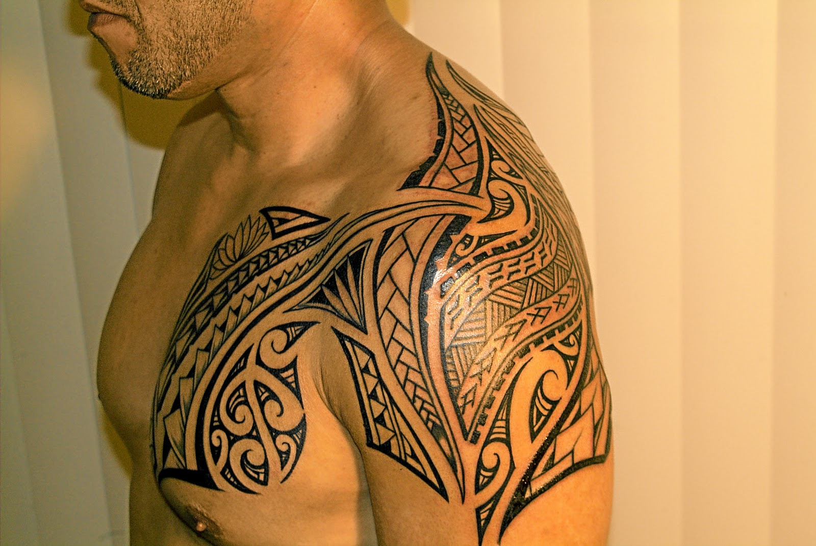 Polynesian shoulder and chest tattoos in 2017 real photo for Polynesian tattoo near me