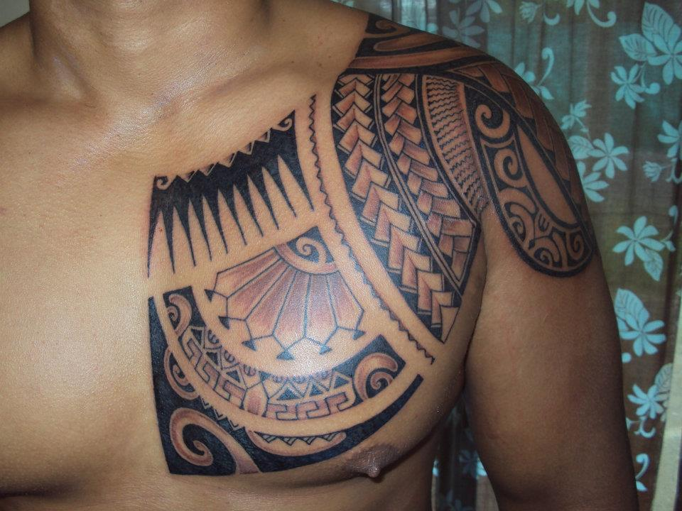 Polynesian Waves And Flower Tattoos On Shoulder photo - 2