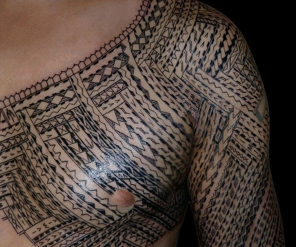 Polynesian Waves And Flower Tattoos On Shoulder photo - 3