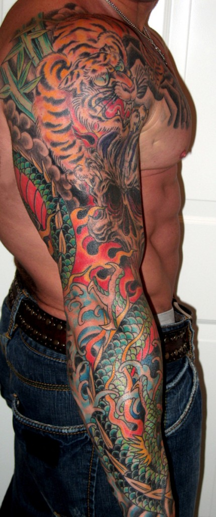 Red Frog Tattoo On Sleeve photo - 1