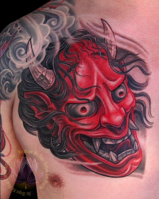 Red Hannya Mask Tattoo On Arm For Men photo - 2