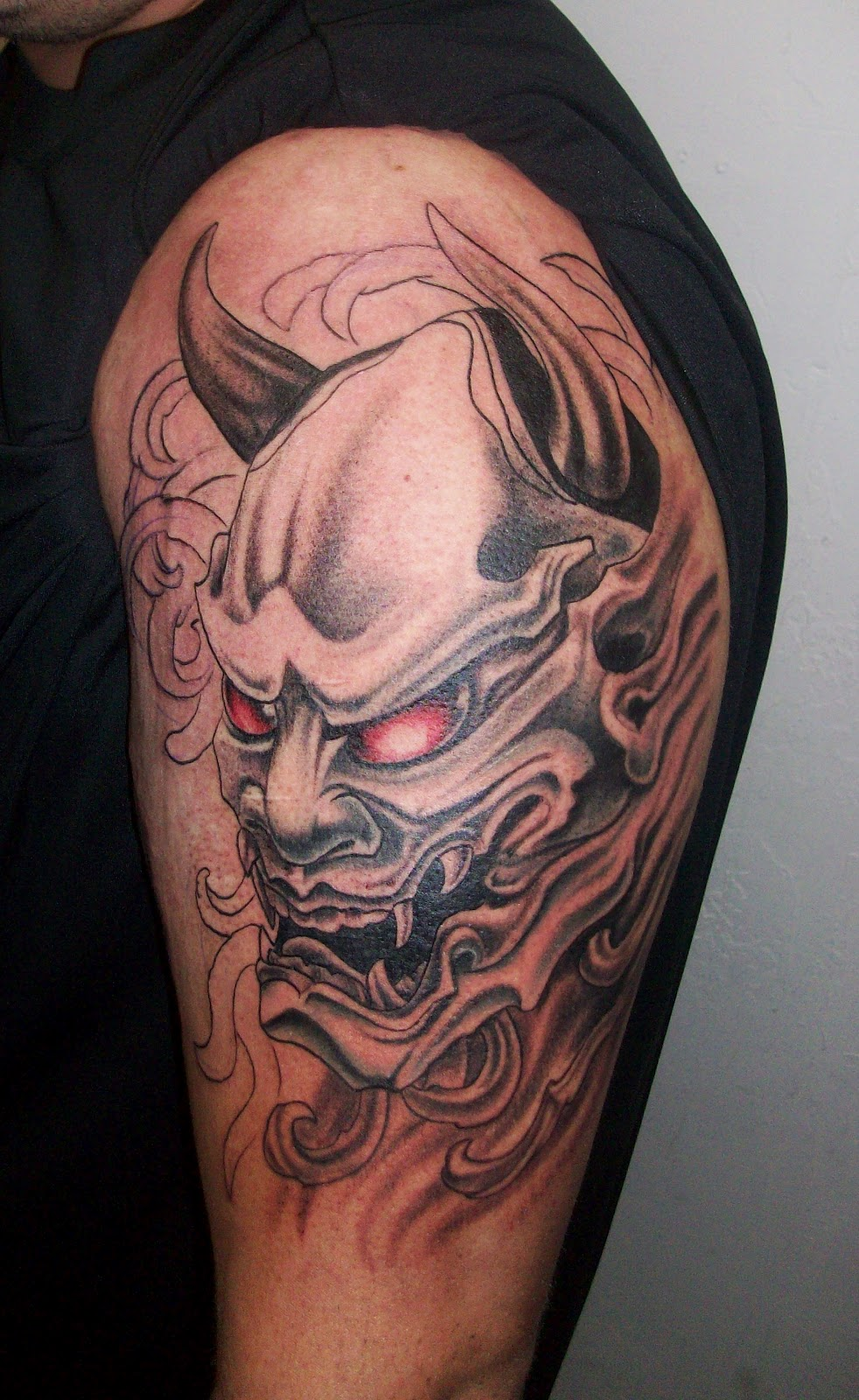 Red Hannya Mask Tattoo On Chest For Men photo - 1