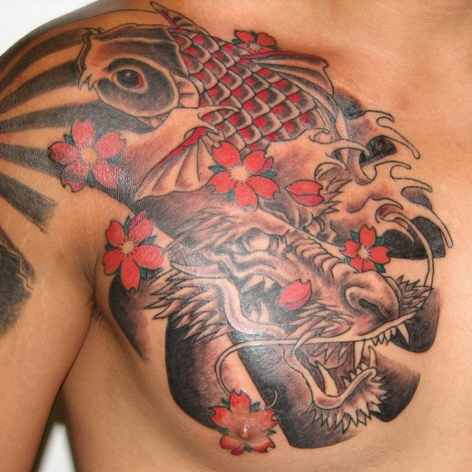 Red Ink Tribal Maple Leaf Tattoo On Upper Back photo - 2