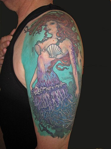Red Tail Flying Mermaid Tattoo On Upper Arm photo - 1