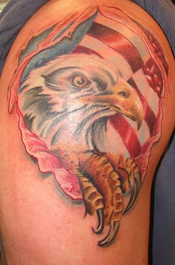 Ripped Skin Mexican Flag Tattoo On Shoulder photo - 1