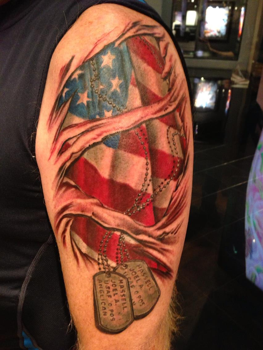 Ripped Skin US Military Tattoo On Arm photo - 1