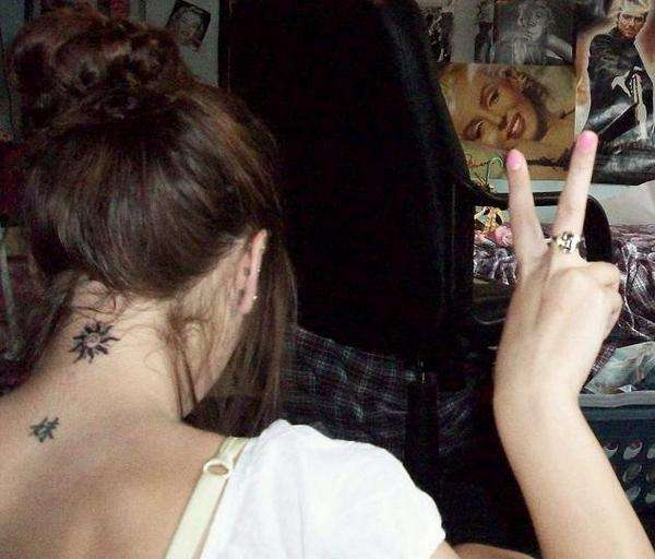 Showing Small Sun Tattoo On Back Neck photo - 1