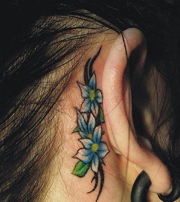 Showing Tribal Flower Tattoo On Hip photo - 3