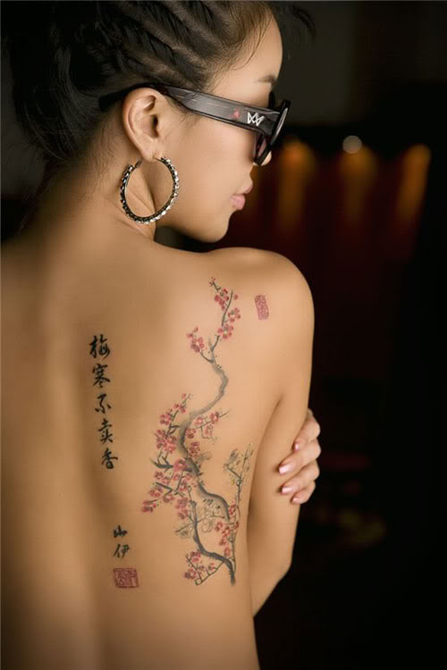 Small Tribal Dolphin Tattoo On Neck Back photo - 1