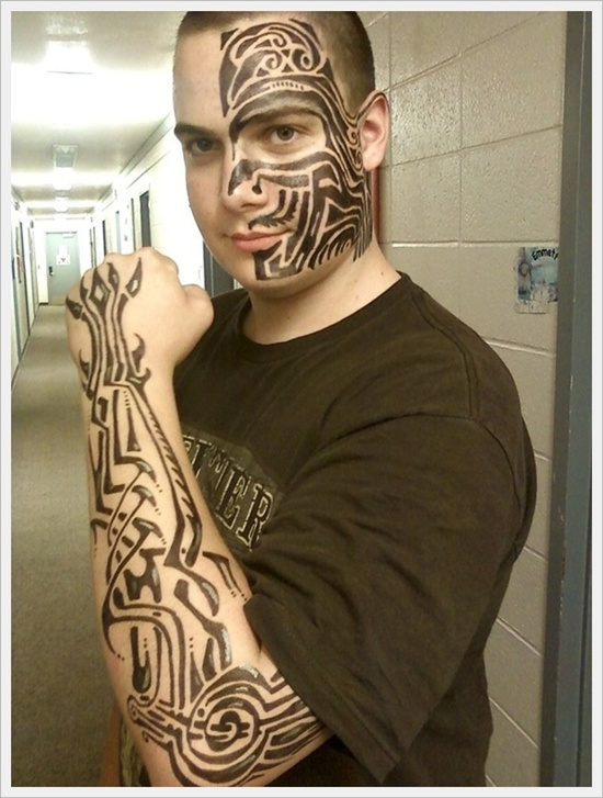 Stylish Tribal Tattoos On Face And Arms photo - 1