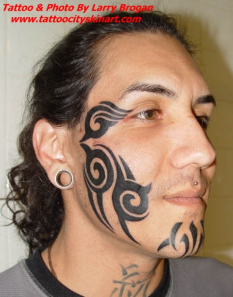 Stylish Tribal Tattoos On Face And Arms photo - 3