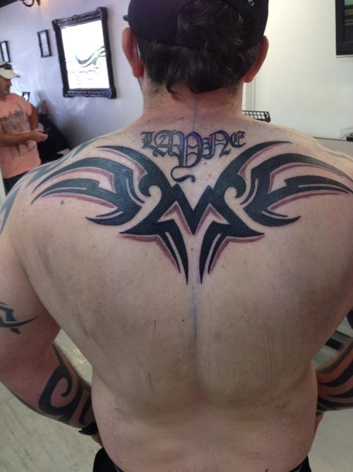 Superb Biomechanical Tattoo On Upper Back photo - 1