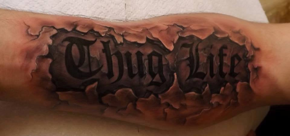 Thug life cracked skin tattoos on arm in 2017 real photo for Thug life tattoo tupac