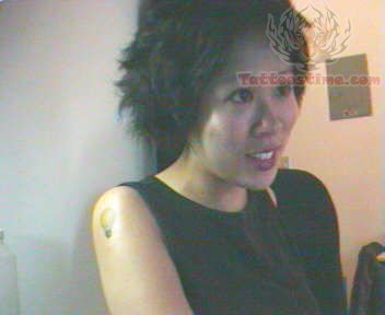 Tiny Bulb Tattoo On Shoulder For Girls photo - 1
