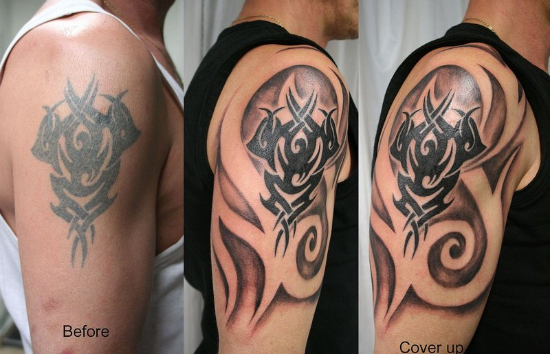 Tribal And Gargoyle Tattoos On Upper Back photo - 3