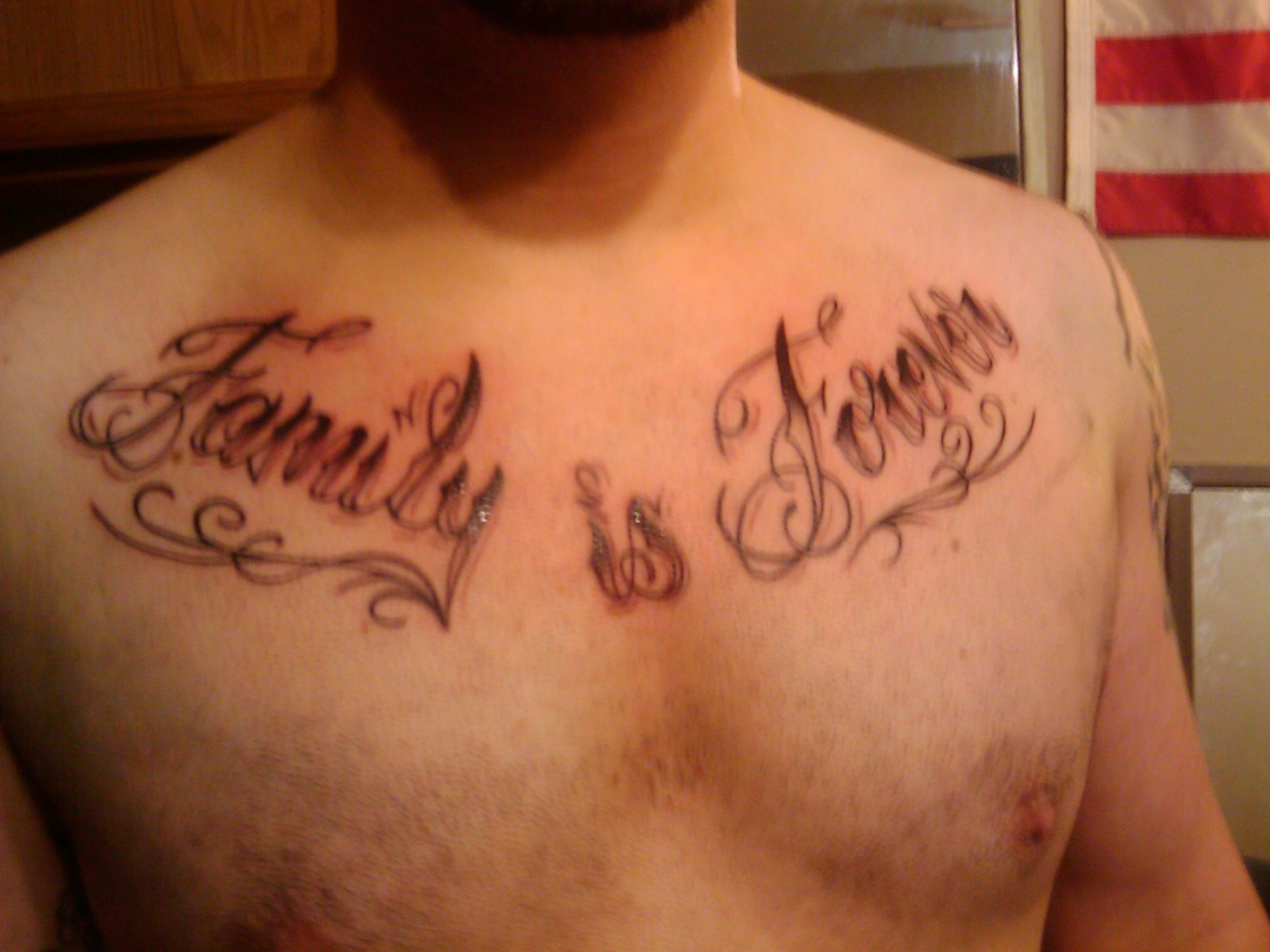Tribal And Lettering Tattoos For Chest photo - 1