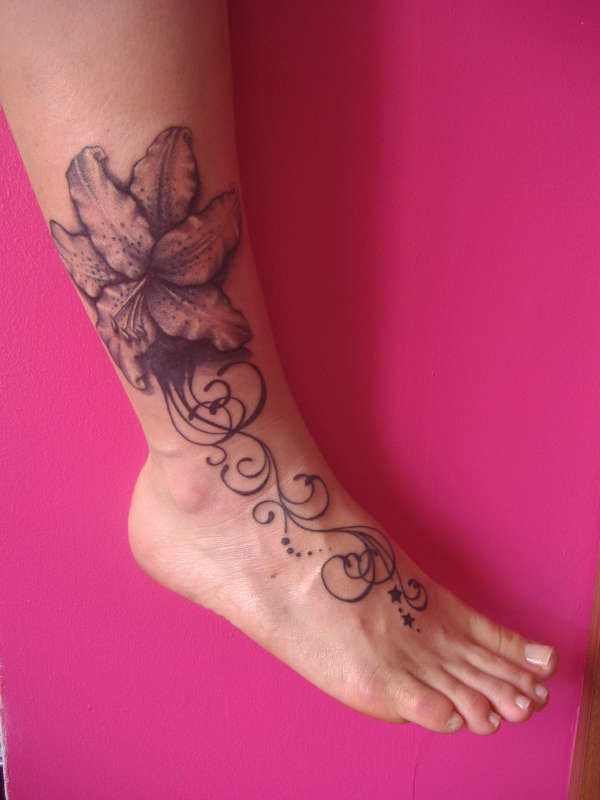 Tribal And Lily Flower Tattoos On Ankle photo - 1