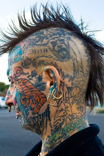 Tribal Angry Lion Tattoo On Back Shoulder photo - 2