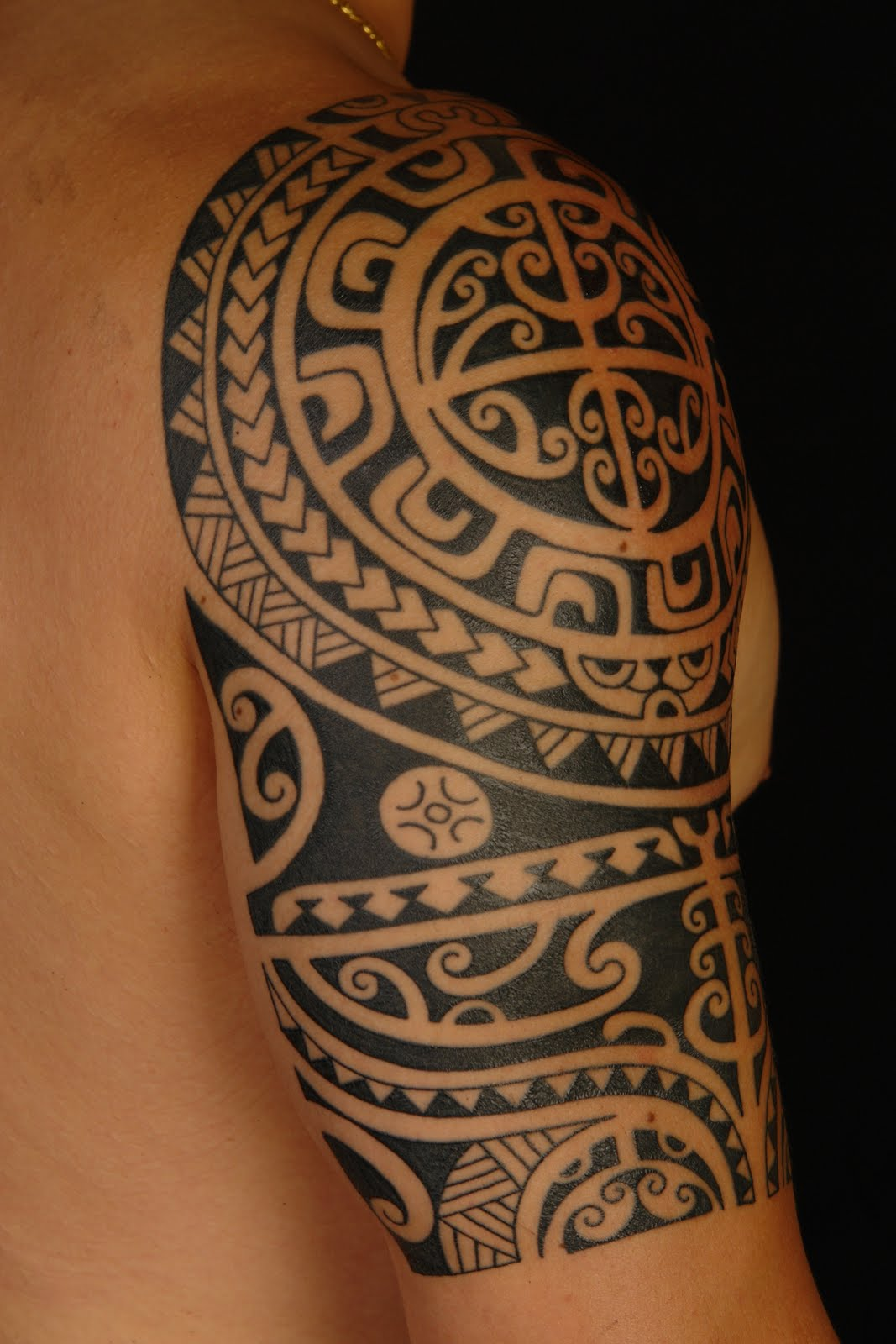 Tribal Aries Tattoo On Mans Shoulder photo - 2