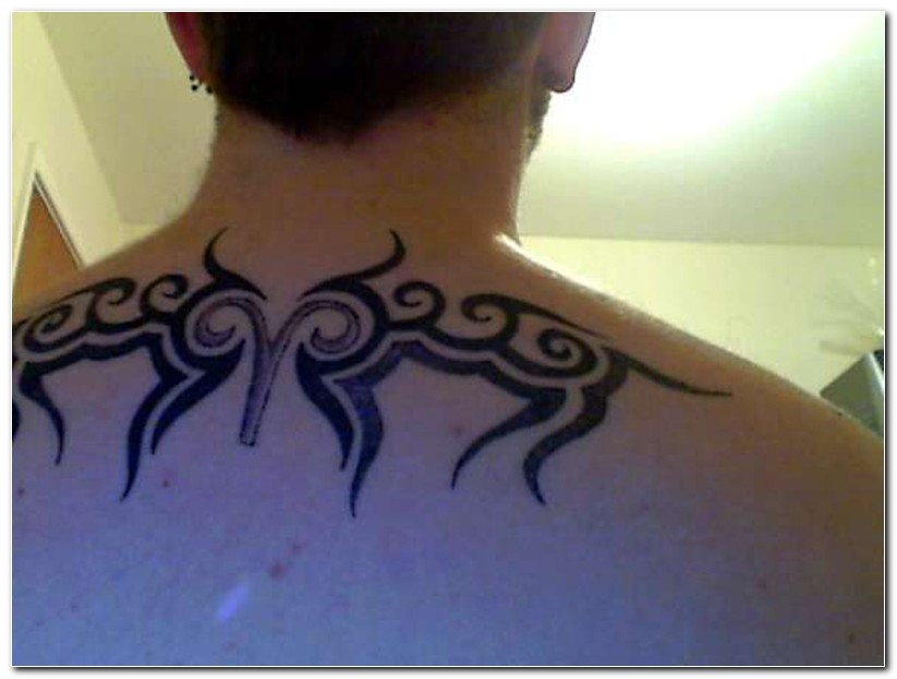 Tribal Aries Tattoo On Upper Back For Women photo - 2