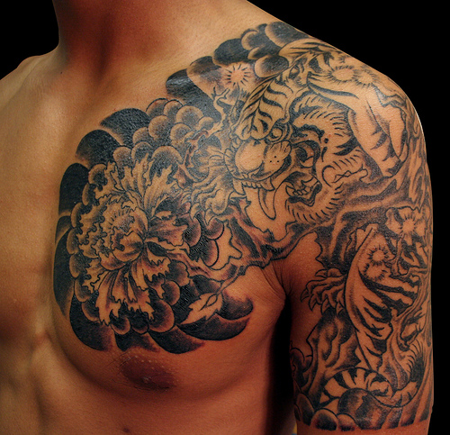 Tribal Elephant Tattoo On Back Shoulder photo - 1