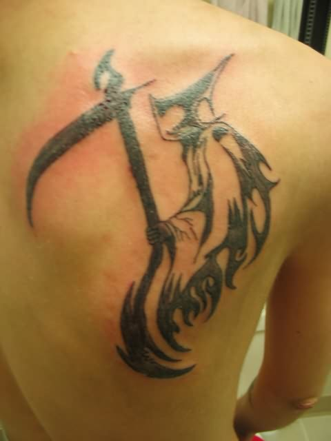 Tribal Grim Reaper Tattoo On Left Shoulder photo - 2