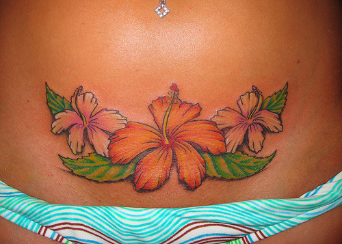 Tribal Hibiscus Flower Tattoos On Back For Girls photo - 1