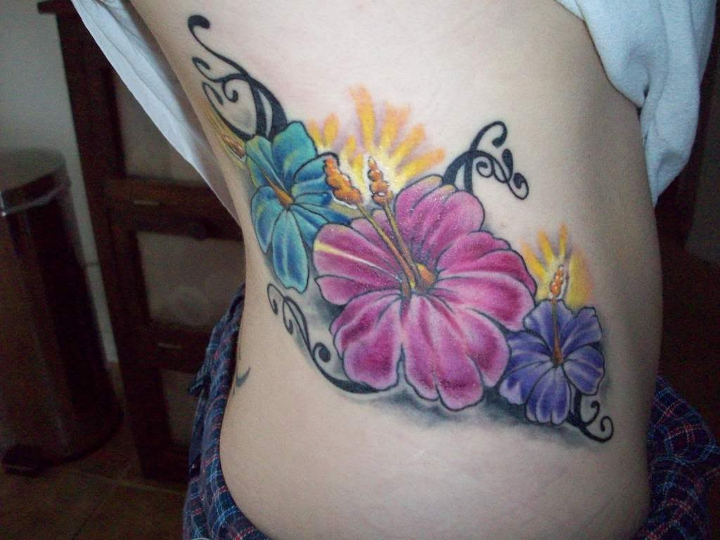 Tribal Hibiscus Flower Tattoos On Back For Girls photo - 3
