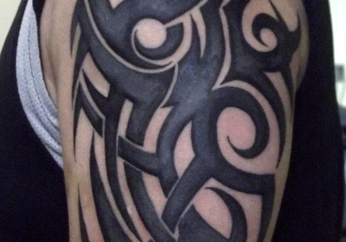 Tribal Horse Tattoo On Biceps photo - 3