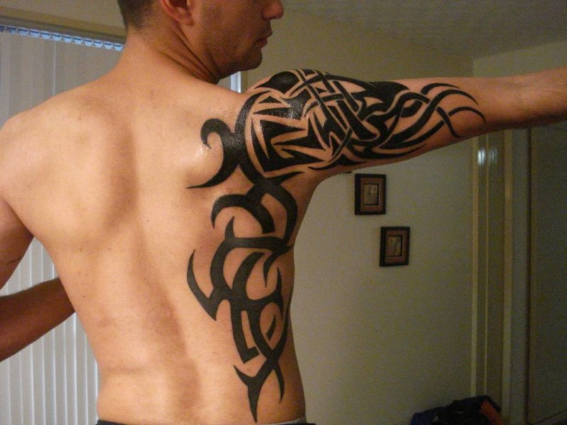Tribal Leo Tattoo On Shoulder photo - 3