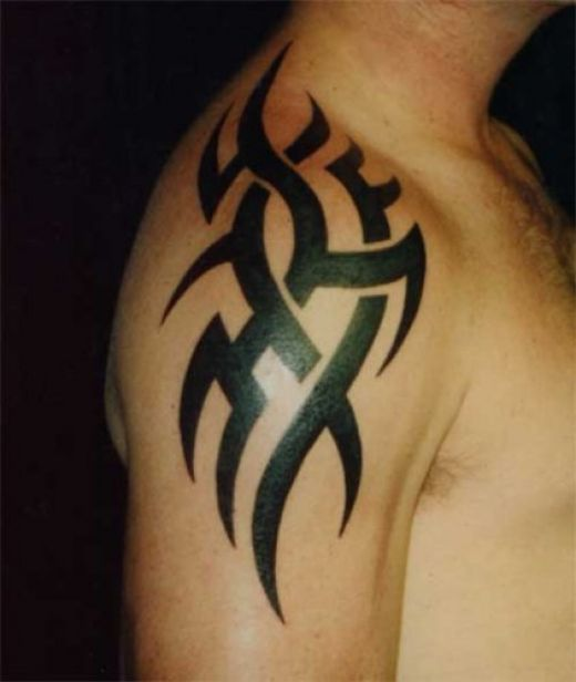 Tribal Libra Tattoo On Upper Back photo - 2