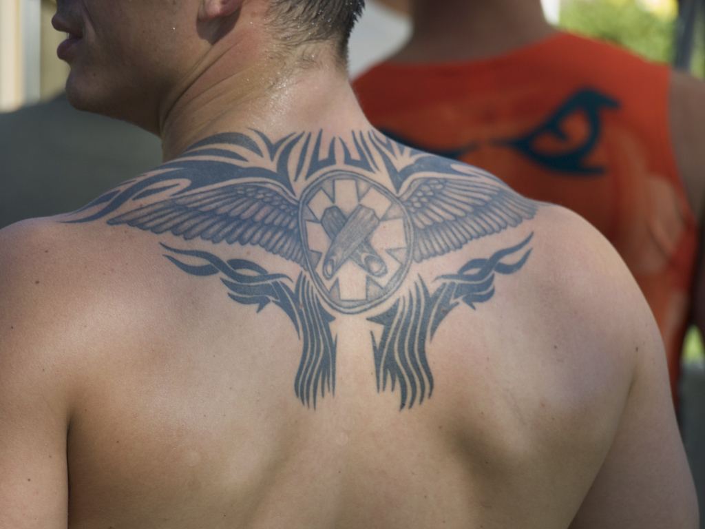 Tribal Military Tattoo On Upper Back photo - 2