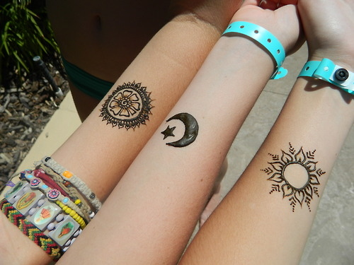 Tribal Sun And Crescent Moon Tattoos On Feet photo - 1