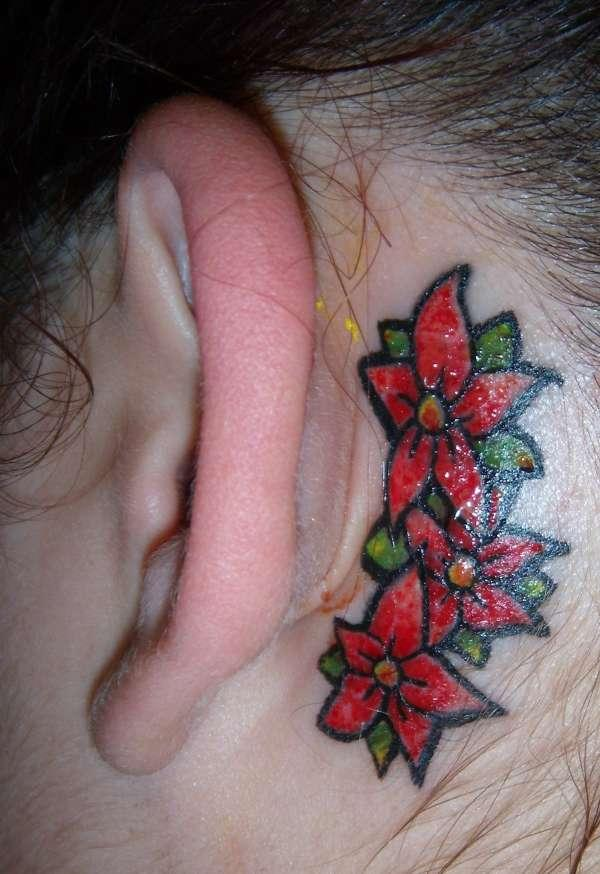 Tribal Tattoo On The Ear photo - 3